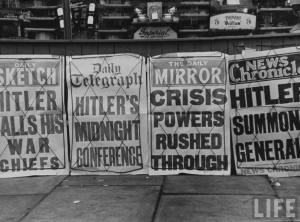 A view of newspapers screaming headlines of war during the outbreak of World War II